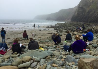Mist rolling in, while the students are busy drawing.